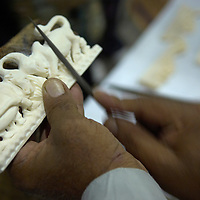 Camel bone ornament being carved by a Pakistani traditional craft worker<br />