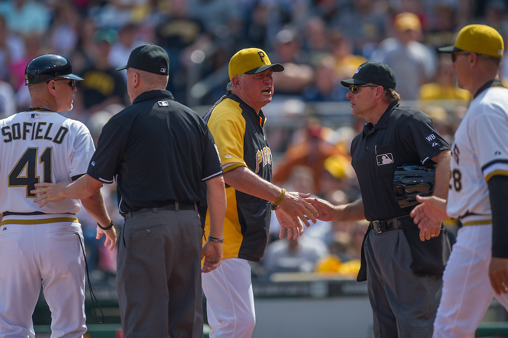 PITTSBURGH, PA - JUNE 08: Russell Martin #55 and Clint Hurdle #13 of the Pittsburgh Pirates exchange emotions with home plate Ed Hickox umpire during the game against the Milwaukee Brewers at PNC Park on June 8, 2014 in Pittsburgh, Pennsylvania. (Photo by Rob Tringali) *** Local Caption *** Russell Martin;Clint Hurdle;Ed Hickox