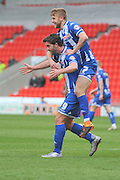 Will Grigg (9) of Wigan Athletic celebrates with Michael Jacobs (17) of Wigan Athletic  after coring to go 1-0 up  during the Sky Bet League 1 match between Doncaster Rovers and Wigan Athletic at the Keepmoat Stadium, Doncaster, England on 16 April 2016. Photo by Ian Lyall.