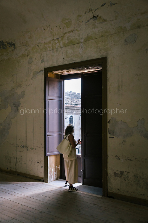 PALERMO, ITALY - 15 JUNE 2018: A visitor is seen here at Palazzo Ajutamicristo during Manifesta 12, the European nomadic art biennal, in Palermo, Italy, on June 15th 2018.<br /> <br /> Manifesta is the European Nomadic Biennial, held in a different host city every two years. It is a major international art event, attracting visitors from all over the world. Manifesta was founded in Amsterdam in the early 1990s as a European biennial of contemporary art striving to enhance artistic and cultural exchanges after the end of Cold War. In the next decade, Manifesta will focus on evolving from an art exhibition into an interdisciplinary platform for social change, introducing holistic urban research and legacy-oriented programming as the core of its model.<br /> Manifesta is still run by its original founder, Dutch historian Hedwig Fijen, and managed by a permanent team of international specialists.<br /> <br /> The City of Palermo was important for Manifesta&rsquo;s selection board for its representation of two important themes that identify contemporary Europe: migration and climate change and how these issues impact our cities.