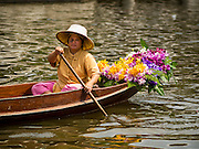 14 FEBRUARY 2015 - BANGKOK, THAILAND: A vendor in her canoe at the new floating market opened in Khlong Phadung Krung Kasem, a 5.5 kilometre long canal dug as a moat around Bangkok in the 1850s. The floating market opened at the north end of the canal near Government House, which is the office of the Prime Minister. The floating market was the idea of Thai Prime Minister General Prayuth Chan-ocha. The market will be open until March 1.    PHOTO BY JACK KURTZ