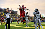 Washington State wide receiver Dom Williams (80) celebrates after scoring a touchdown during the second half of an NCAA college football game against Oregon Saturday, Oct. 10, 2015, in Eugene, Ore. (AP Photo/Ryan Kang)