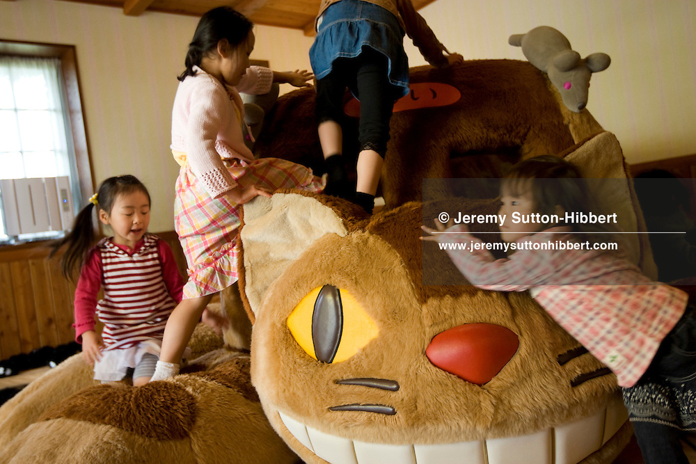 "Children play on the ""Cat Bus""- a soft play-area recreation of a character from the animated film 'My Neighbour Totoro', inside Hayao Miyazaki's Ghibli Museum, in Tokyo, Japan. Wednesday 8th April 2009."