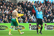 Picture by Paul Chesterton/Focus Images Ltd.  07904 640267.11/02/12.Referee Martin Atkinson books Grant Holt of Norwich for taking his shirt off during the celebration of his 2nd goal of the game during the Barclays Premier League match at Liberty Stadium, Swansea.