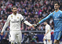 February 9, 2019 - Madrid, Madrid, Spain - Sergio Ramos and Courtois of Real Madrid in action during La Liga Spanish championship, , football match between Atletico de Madrid and Real Madrid, February 09th, in Wanda Metropolitano Stadium in Madrid, Spain. (Credit Image: © AFP7 via ZUMA Wire)