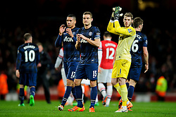 L-R Man Utd Defender Chris Smalling (ENG), Defender Nemanja Vidic (SRB) and Goalkeeper David De Gea (ESP) look disappointed as they applaud the away supporters after the game ends with a 0-0 draw - Photo mandatory by-line: Rogan Thomson/JMP - 07966 386802 - 12/02/14 - SPORT - FOOTBALL - Emirates Stadium, London - Arsenal v Manchester United - Barclays Premier League.