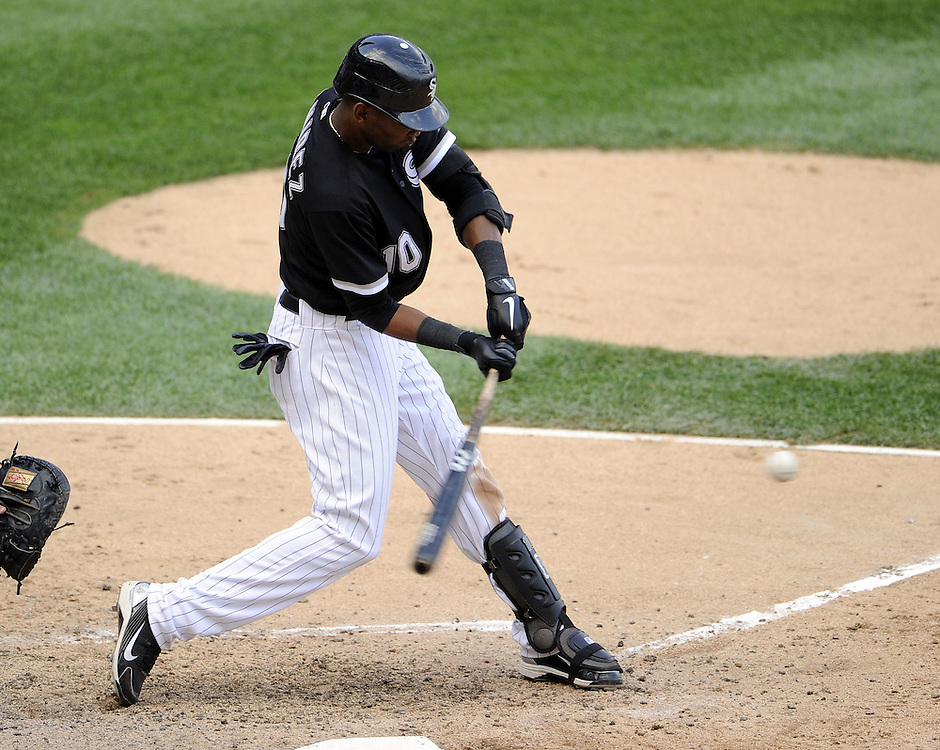 CHICAGO - JULY 09:  Alexei Ramirez #10 of the Chicago White Sox singles to drive in the game winning run in the bottom of the ninth inning against the Minnesota Twins on July 9, 2011 at U.S. Cellular Field in Chicago, Illinois.  The White Sox defeated the Twins 4-3.  (Photo by Ron Vesely)  Subject: Alexei Ramirez