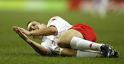 CARDIFF, WALES - WEDNESDAY FEBRUARY 9th 2005: Wales' goalscorer Craig Bellamy lies injured after a late Hungary challenge during the International Friendly match at the Millennium Stadium. (Pic by Jason Cairnduff/Propaganda)