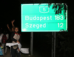 © London News Pictures. Migrants break from a police corden close to the Hungarian and Serbian border town of Roszke, Hungary, September 8 2015. The UN's humanitarian agencies are on the verge of bankruptcy and unable to meet the basic needs of millions of people because of the size of the refugee crisis in the Middle East, Africa and Europe, senior figures within the UN have told the media.   Picture by Paul Hackett /LNP