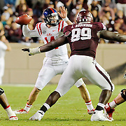 Mississippi quarterback Bo Wallace (14) releases a pass during the second half of an NCAA college football game against Texas A&M in College Station, Texas, Saturday, Oct. 11, 2014. No. 3 Mississippi won 35-20. (Photo/Thomas Graning)