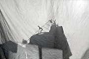clothing on drying rack projection on sheet