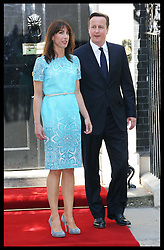 Prime Minister David Cameron and  wife Samantha wait to greet The Queen and Duke of Edinburgh for lunch along with former Prime Minister's at 10 Downing St.,London,  Tuesday, 24th July 2012.  Photo by: Stephen Lock / i-Images