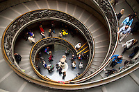 Visitors of the Vatican Museum, Vatican City, Rome Italy, desend on a spiral staircase that takes them to the exit of the museum. Over 4 million people per year visit the museum.