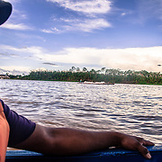 Guajarà-Mirim, Brazil. After a long day at work, Jorge takes the boat that will take him back home, on the other side of Marmore river, in Guayaramerin, Bolivia. He commutes every day between Brazil and Bolivia