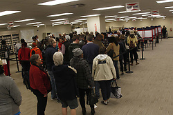 November 2, 2018 - Cincinnati, Ohio, U.S. - Voters stand in line inside of the  Board of Education on Fri Nov 2, 2018 to put in his early vote in Cincinnati,Ohio. As lots of locals made the drive to get there vote  in ahead of the National voting day on Nov 6, 2018. (Credit Image: © Ernest Coleman/ZUMA Wire)