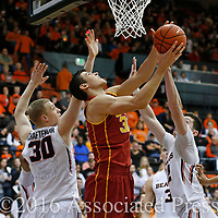 USC's Nikola Jovanovic, center, goes to the basket while being guarded by Oregon State's Olaf Schaftenaar, left, and Drew Eubanks, right, in the second half of an NCAA college basketball game in Corvallis, Ore., on Sunday, Jan. 24, 2016. Oregon State won 85-70. (AP Photo/Timothy J. Gonzalez)