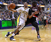 March 13, 2012; Indianapolis, IN, USA; Indiana Pacers shooting guard George Hill (3) loses the handle on the ball as Portland Trail Blazers point guard Raymond Felton (5) defends at Bankers Life Fieldhouse. Mandatory credit: Michael Hickey-US PRESSWIRE