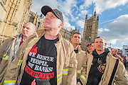 Firemen queue to get into Parliament. Led by Matt Wrack, The Fire Brigades Union holds a protest rally and march.  Stating at Methodist Central Hall and then heading for Parliament. They are demanding a farer pension settlement and a rethink of the increased retirement age. They accuse Penny Mordaunt, the minister responsible, of lieing to them about the changes and their impact. Westminster London, UK 25 Feb 2015.
