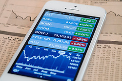 Detail of iPhone 5 smart phone screen showing financial app with Dow Jones stock market data