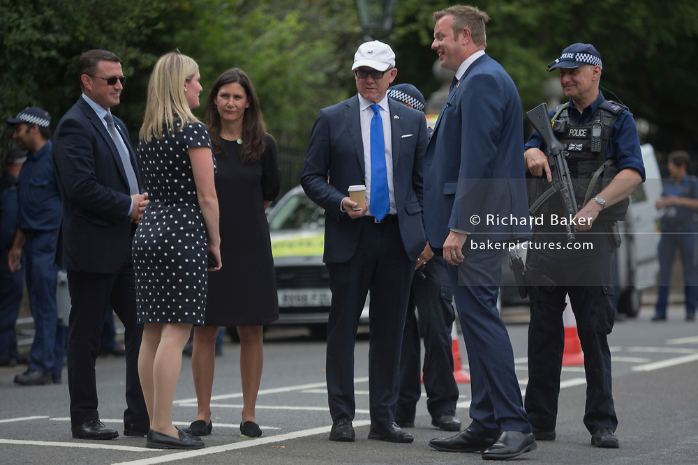 The American Ambassador to the UK, Robert Wood 'Woody' Johnson IV (in the white cap) inspects security with his staff outside Winfield House, his official residence during the visit to the UK of US President, Donald Trump, on 12th July 2018, in Regent's Park, London, England.