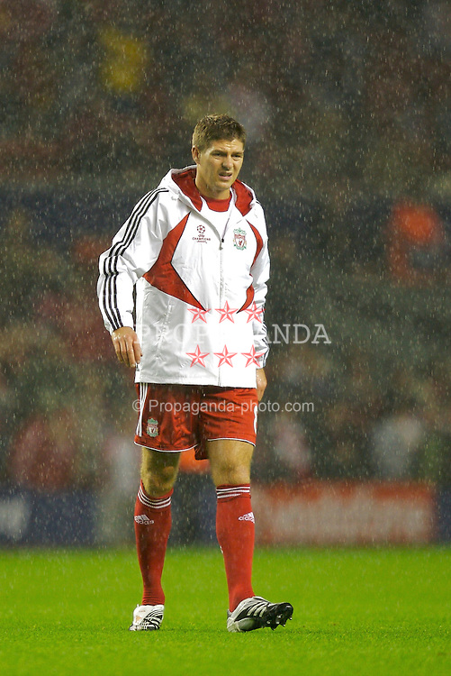 Liverpool, England - Wednesday, October 3, 2007: Liverpool's Steven Gerrard MBE warms-up in the rain before the UEFA Champions League Group A match against Olympique de Marseille at Anfield. (Photo by David Rawcliffe/Propaganda)
