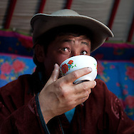 Mongolia. portrait of a nomad  drinking the fermented milk,ayrak in the yurt.  cattle breeders in the countryside near Bayanchandmani.  Lun -