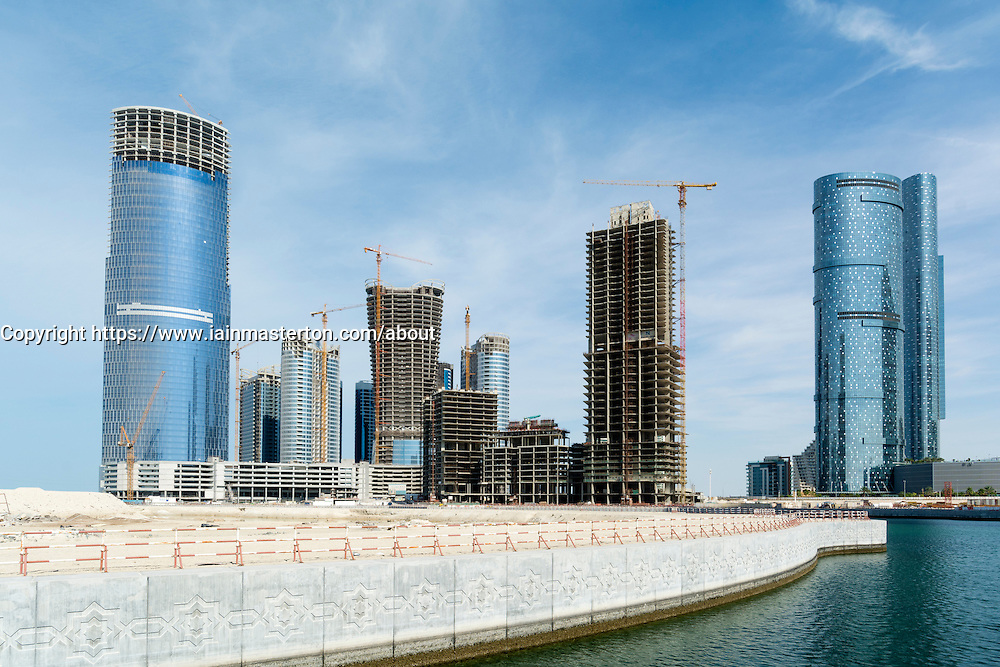 Many high-rise office and apartment towers under construction  on Al Reem Island new CBD in Abu Dhabi United Arab Emirates.