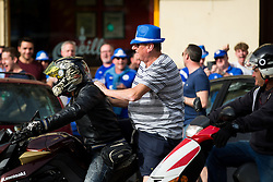 A supporter boards a locals motorbike at the traffic lights as Leicester City fans take over O'Neils Irish bar in Seville before the game - Rogan Thomson/JMP - 22/02/2017 - FOOTBALL - Estadio Ramon Sanchez Pizjuan - Seville, Spain - Sevilla FC v Leicester City - UEFA Champions League Round of 16, 1st Leg.
