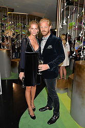 ALISTAIR GUY and BARBORA BEDIOVA at the opening of L'Eden by Perrier-Jouet held at The Unit, 147 Wardour Street, Soho, London on 15th September 2016.