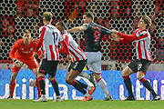 Brentford defender Mads Bech Sørensen (29) tugs at the arm of Stoke City forward Sam Vokes (9) during the The FA Cup match between Brentford and Stoke City at Griffin Park, London, England on 4 January 2020.