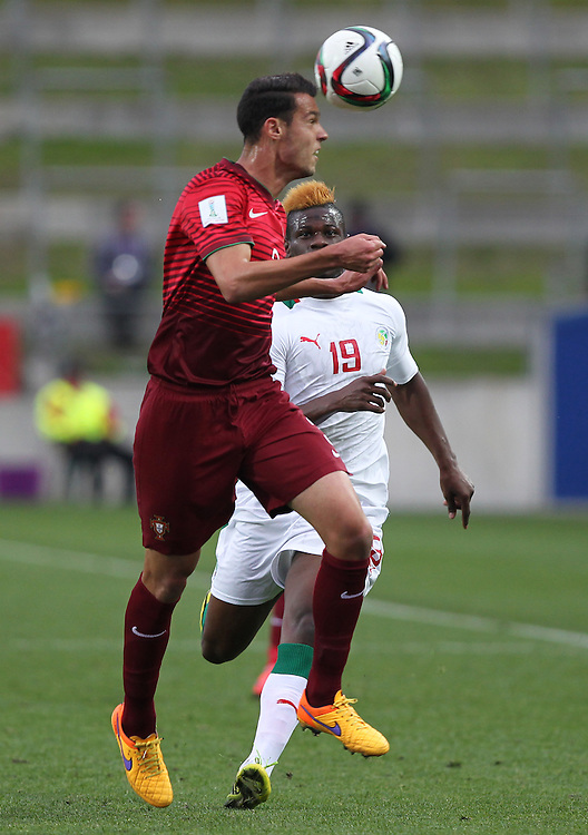 Joao Nunes of Portugal looks to clear the ball under pressure from Mamadou Thiam of Senegal in the group c game of the FIFA u20 World Cup at Waikato Stadium, Hamilton, New Zealand, Sunday, May 31, 2015. Credit:SNPA / Ben Campbell