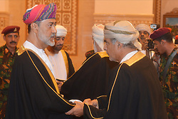 HandOut photo - New sworn-in Sultan Haitham Bin Tariq Bin Taimour of Oman (left) receives the congratulations of members of the Royal Family and other officials during a ceremony held in Muscat, Oman, on January 11, 2020, few hours after Sultan Qaboos Bin Said passed away. Photo by Balkis Press/ABACAPRESS.COM