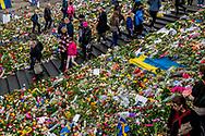STOCKHOLM - People gather at a makeshift memorial to commemorate the victims of Fridays terror attack near the site where a truck drove into a department store in Stockholm, Sweden, on April 10, 2017.Four people died and fifteen were injured when a truck plunged into a crowd at a busy pedestrian street in the Swedish capital on 7 april . copyreight robin utrecht STOCKHOLM - Een bloemenzee op de plek van de aanslag in het centrum van Stockholm. Inwoners van de Zweedse stad zijn bijeen om de slachtoffers van de aanslag met een vrachtwagen op 7 april 2017 ter herdenken. <br /> STOCKHOLM - People gather at a makeshift memorial to commemorate the victims of Fridays terror attack near the site where a truck drove into a department store in Stockholm, Sweden, on April 10, 2017.Four people died and fifteen were injured when a truck plunged into a crowd at a busy pedestrian street in the Swedish capital on 7 april . copyreight robin utrecht