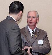Vern Oakley of Miller-Valentine Group (right) during the Dayton Area Chamber of Commerce Breakfast Briefing at the Dayton Racquet Club in downtown Dayton, Friday, January 13, 2012.