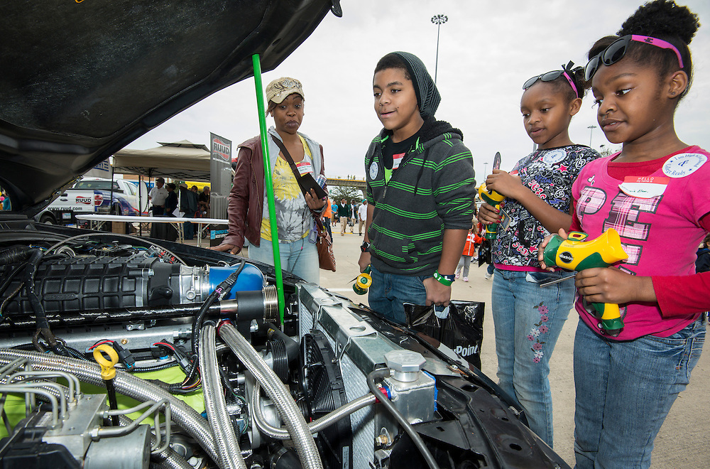 Students and parents check out the Chavez High School motorsports exhibit at the When I Grow Up fair, March 8, 2014.
