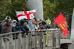 © Licensed to London News Pictures. 17/10/2015. Bristol, UK.  Bristol Patriots on the march.  Bristol Patriots vs Anti-Fascists twin demonstrations in Bristol city centre.  The Bristol Patriots were marching against 'Somali rape gangs' and immigration, and the Anti-Fascists opposed them.  Violence flared between Anti-Fascists and police who made several arrests. Photo credit : Simon Chapman/LNP