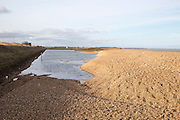 Shingle beach and lagoon at East Lane, Bawdsey, Suffolk, England, UK