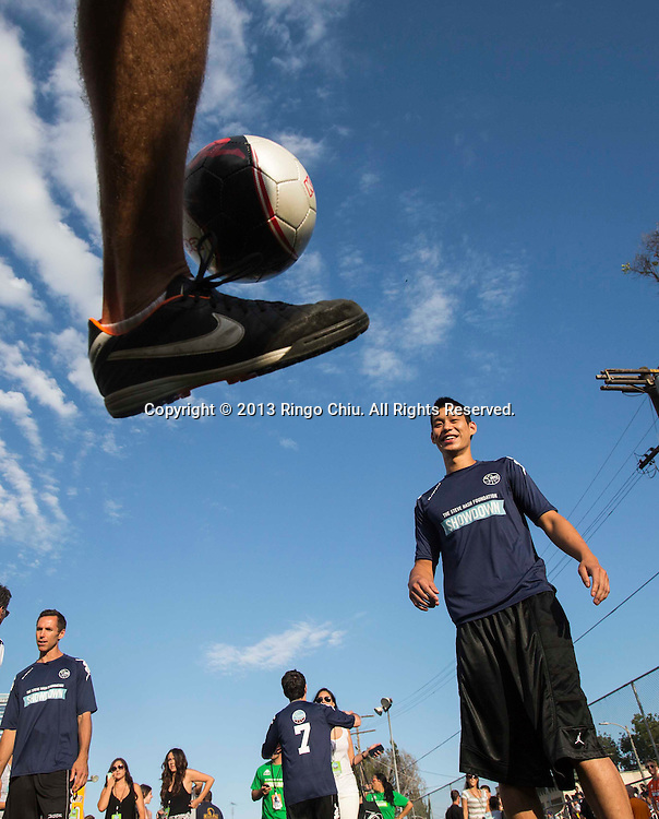 Basketball Player Jeremy Lin warms up with a soccer ball as he attends Steve Nash Foundation Showdown, a competitive pick-up-style charity soccer match, at the Salvation Army Red Shield Community Center on July 14, 2013 in Los Angeles California. (Photo by Ringo Chiu/PHOTOFORMULA.com)