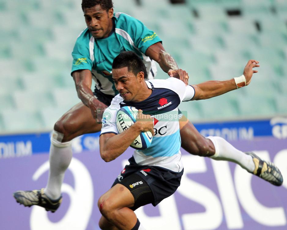 Afa Pakalani dives over to score a try. NSW Waratahs v Fiji. Investec Super Rugby Preseason match, 04 February 2011 SYdney Football Stadium, Australia. Photo: Clay Cross / photosport.co.nz