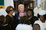 Democratic presidential hopeful former Vice President Joe Biden takes a selfie with supporters following the Sunday service at the Morris Brown AME Church July 7, 2019 in Charleston, South Carolina. South Carolina, called the First in the South, is the first southern democratic primary in the presidential nomination race.