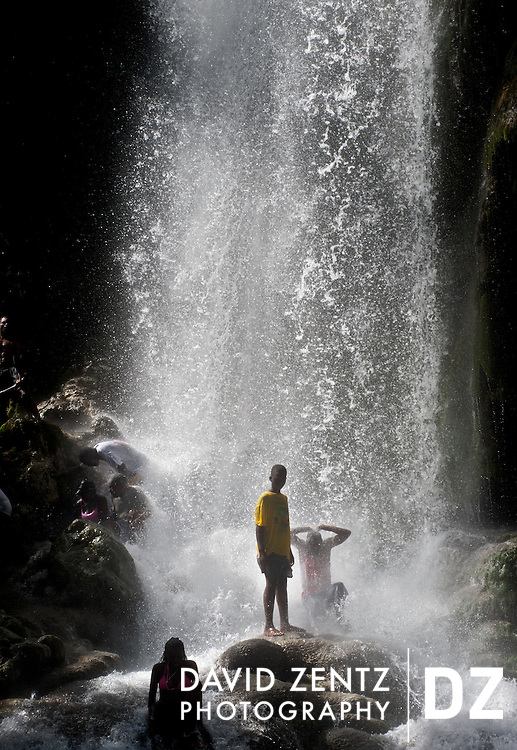 Young pilgrims stand beneath the cascading falls at Saut D'eau during the annual voodoo festival held there in July. Thousands, from across the country, descend on the small town to cleanse themselves of negative energy, welcome in the good, ask their spirits for help.