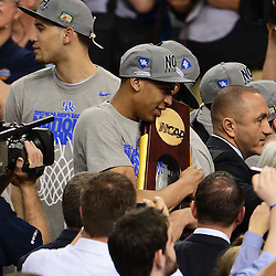 Apr 2, 2012; New Orleans, LA, USA; Kentucky Wildcats forward Anthony Davis hugs the NCAA National Championship trophy after defeating the Kansas Jayhawks 67-59 in the finals of the 2012 NCAA men's basketball Final Four at the Mercedes-Benz Superdome. Mandatory Credit: Derick E. Hingle-US PRESSWIRE
