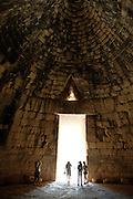 Guests from the Sea Cloud view the inside of the Treasury of Atreus, a royal tomb at Mycenae near Nafplion, Greece.