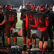 November 06, 2015; Oregon City, OR, USA; Players warm themselves on the sidelines. Oregon City hosted Southridge at Pioneer Stadium.  Photo by David Blair