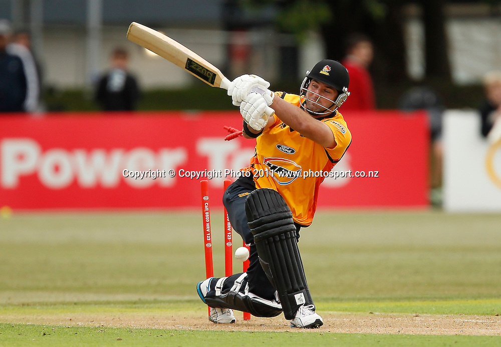 Luke Woodcock of the Firebirds is bowled during the HRV Cup Cricket Twenty-20,  Auckland Aces v Wellington Firebirds, Colin Maiden Park Auckland, Sunday 18 December 2011. Photo: Simon Watts/www.photosport.co.nz