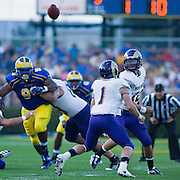 West chester quarterback Matt Carroll #12 lost sight of the ball during the snap during a Week 2 NCAA football game against Westchester in the first quarter.  ..#8 Delaware defeated Westchester 28-17  in their home opener at Delaware Stadium Saturday Sept. 10, 2011 in Newark DE...Delaware will return home Sept. 17, 2011 for a showdown with interstate Rival Delaware State at 6:pm at Delaware Stadium. (Monsterphoto/Saquan Stimpson)