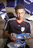 Devon Climmons sits with some of his sports equipment, Saturday, August 11, 2007.
