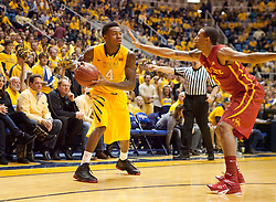 West Virginia Mountaineers guard Daxter Miles Jr. (4) looks to pass the ball against the Iowa State Cyclones during the first half at the WVU Coliseum.