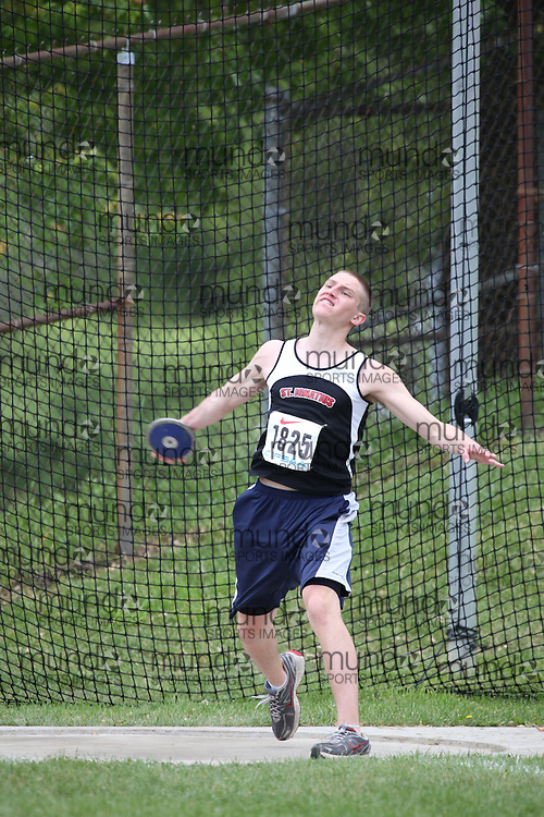 Thomas Walser of St Ignatius HS - Thunder Bay competes in the midget boys discus at the 2013 OFSAA Track and Field Championship in Oshawa Ontario, Thursday,  June 6, 2013.<br /> Mundo Sport Images / Sean Burges
