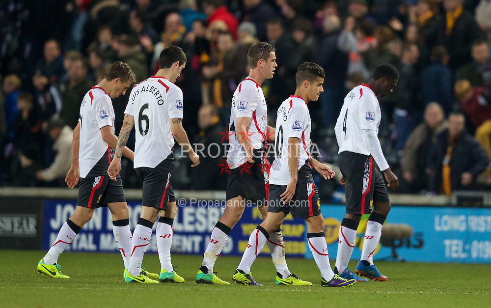 HULL, ENGLAND - Sunday, December 1, 2013: Liverpool players Lucas Leiva, Luis Alberto, Jordan Henderson, Philippe Coutinho Correia and Kolo Toure walk off dejected after losing 3-1 to Hull City during the Premiership match at the KC Stadium. (Pic by David Rawcliffe/Propaganda)